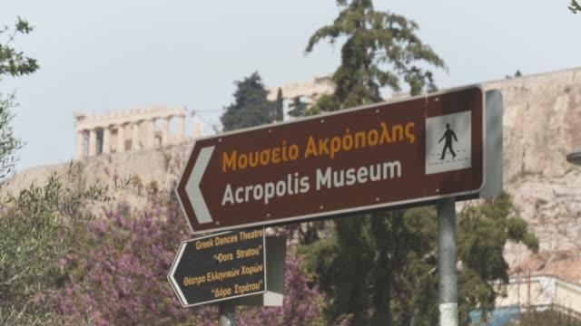 athens, greece - acropolis museum sign during coronavirus - covid-19 lockdown, 4k. - parthenon athens stock videos & royalty-free footage