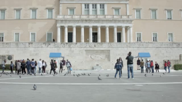 Athens - Timelapse - 4K RAW footage - tourists at Syntagma square, in front of the Greek Parliament and the presidential guard