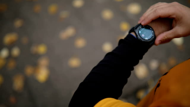 athlete adjusting smart watch before jogging - stop watch stock videos & royalty-free footage