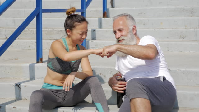 athlete bearded old man and asian communicate - kharkov stock videos & royalty-free footage