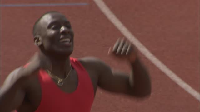 HA CU Athlete celebrating after winning race / Sheffield, England, UK