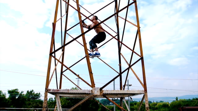 athlete climbing on the tower - tracksuit bottoms stock videos & royalty-free footage