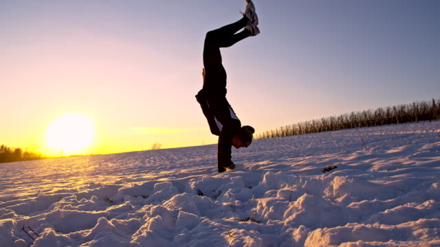 WS Athlete Doing A Handstand In The Snow