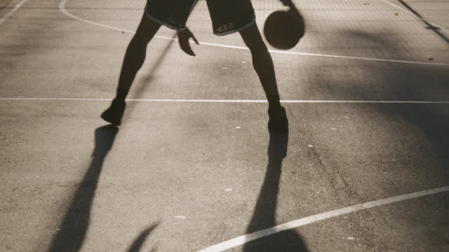 athlete dribbling ball on basketball court - bouncing stock videos & royalty-free footage