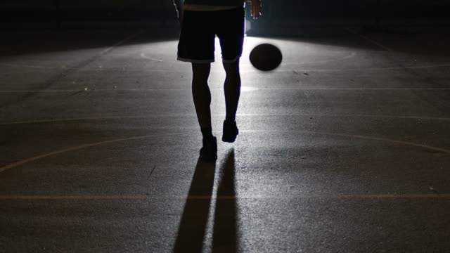athlete dribbling basketball on street at night - bouncing stock videos & royalty-free footage