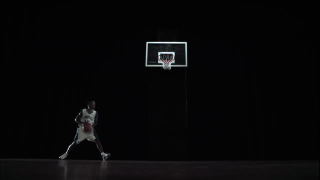 ws slo mo athlete dribbling putting ball in basket / beaverton, or, usa - basketball ball stock videos & royalty-free footage