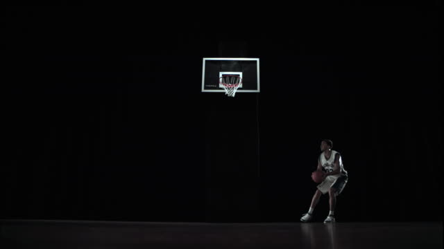 WS SLO MO Athlete dribbling putting ball in basket / Beaverton, OR, USA
