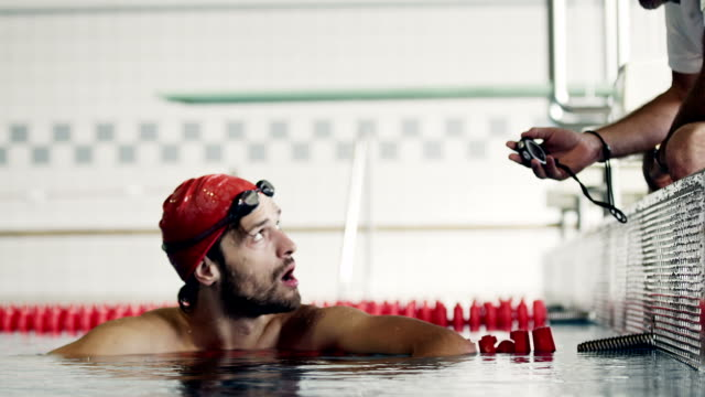 athlete in water - stop watch stock videos & royalty-free footage