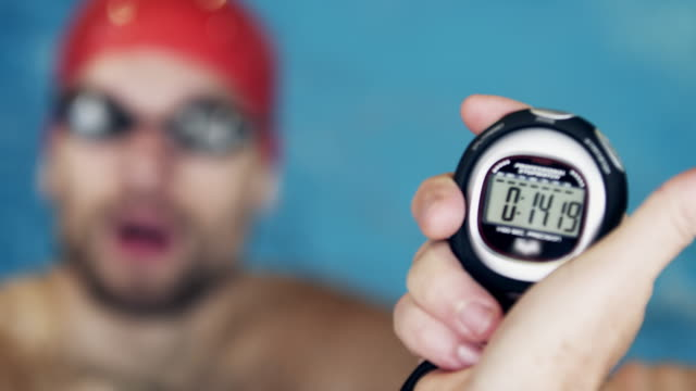 athlete in water - timer stock videos & royalty-free footage