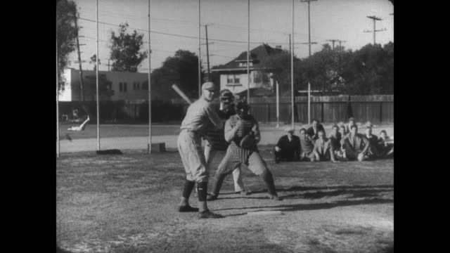 1927 athlete (buster keaton) is held responsible for three outs - losing virginity stock videos & royalty-free footage