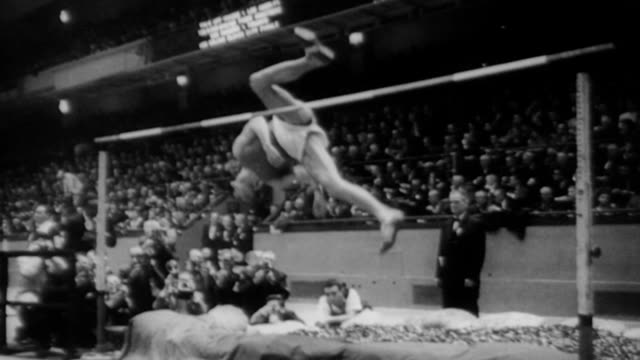 athlete john thomas jumps over high jump in front of crowded stadium / valery brumel russian athlete follows thomas over the high jump / brumel wins... - world record stock videos & royalty-free footage