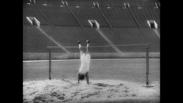 1927 Athlete (Buster Keaton) practices the high jump with mostly successful results