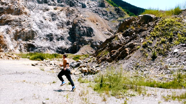athlete running in the quarry - tracksuit bottoms stock videos & royalty-free footage