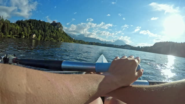 pov athlete sculling in sunshine - sculling stock videos & royalty-free footage