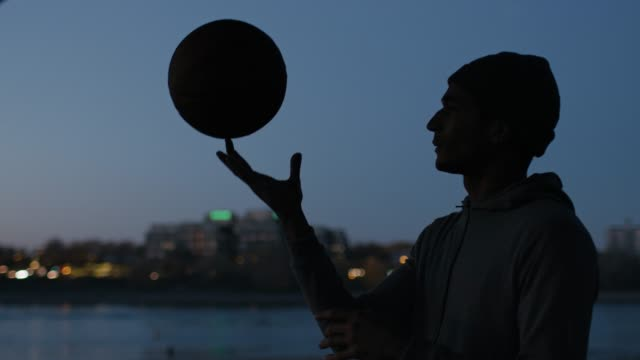 athlete spinning basketball on finger at night - finger stock videos & royalty-free footage