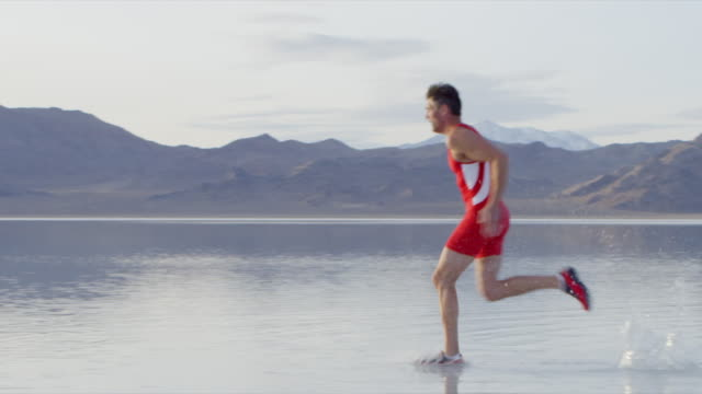 MS PAN Athlete sprinting across surface of lake