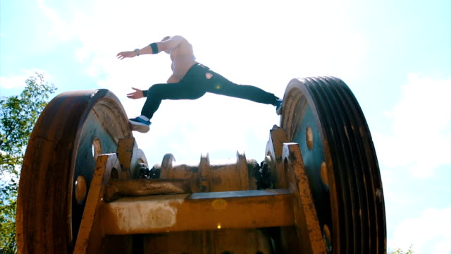 athlete stretching on the machinery - tracksuit bottoms stock videos & royalty-free footage