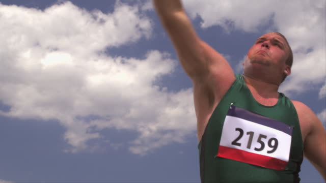 a athlete throws a shot put ball. - shot put stock videos & royalty-free footage