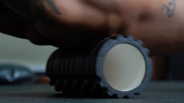 Athlete using foam roller - Stretching