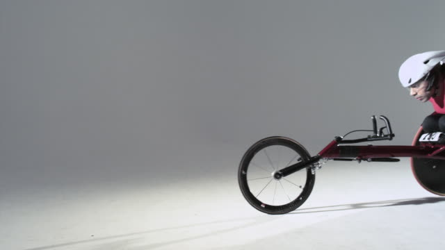 athlete using wheelchair - スタジオ撮影点の映像素材/bロール