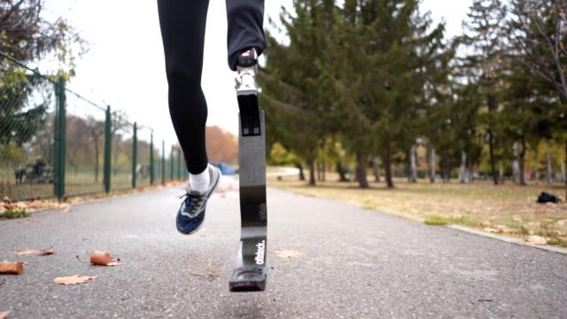athlete with a artificial leg running outdoors - human limb stock videos & royalty-free footage