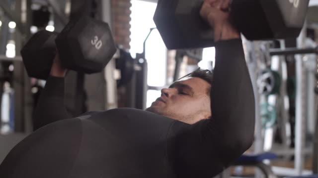 athlete with dumbbell exercising/ mielec/ poland - podkarpackie voivodeship video stock e b–roll