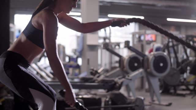 athlete with ropes exercising/ mielec/ poland - podkarpackie voivodeship video stock e b–roll