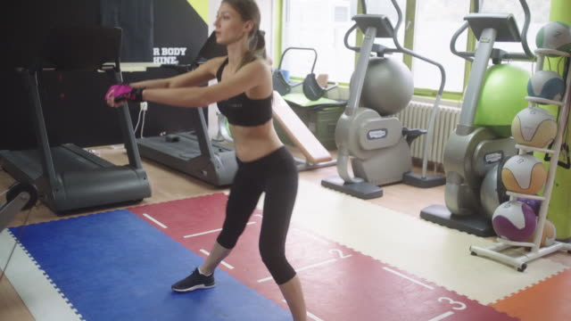 Athlete woman exercising in gym