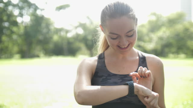 athlete woman using smart watch for monitoring her running performance on smartwatch - wrist stock videos & royalty-free footage