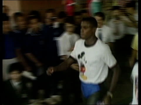 Athletes arrive for final training sessions ahead of Seoul Olympics ITN Tokyo Narita Airport Florence Griffith Joyner arriving as press throng around...