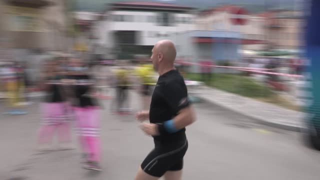athletes compete in the two cities marathon in sarajevo, bosnia and herzegovina on july 26, 2020. the route of the 42.2 kilometers international... - bosnia and hercegovina stock videos & royalty-free footage