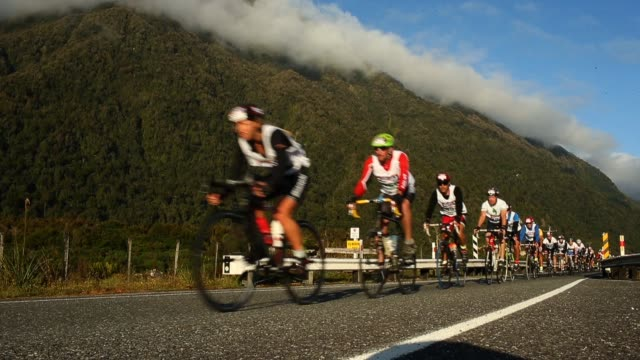 athletes compete on the first cycle leg in the individual two day event during the 2013 speights coast to coast on february 8, 2013 in greymouth, new... - individual event stock videos & royalty-free footage