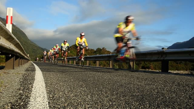 athletes compete on the first cycle leg in the individual two day event during the 2013 speights coast to coast on february 8 2013 in greymouth new... - individual event stock videos & royalty-free footage