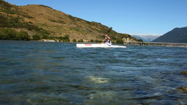 athletes compete on the kayak leg in the individual one day event during the 2013 speights coast to coast on february 9, 2013 in greymouth, new... - individual event stock videos & royalty-free footage