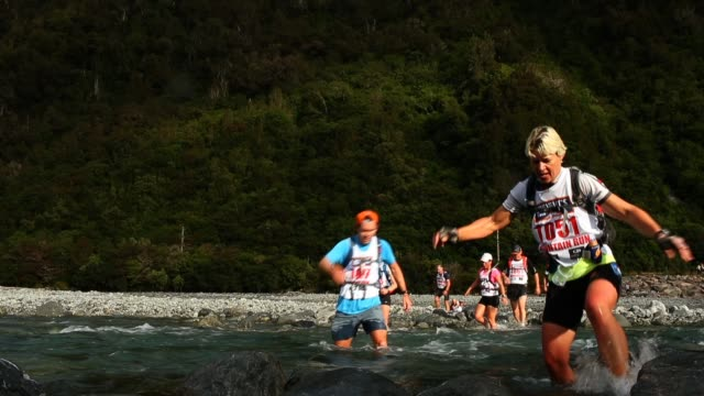 athletes compete on the mountain run leg in the individual one day event during the 2013 speights coast to coast on february 9 2013 in greymouth new... - individual event stock videos & royalty-free footage