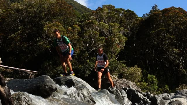 athletes compete on the mountain run leg in the individual two day event during the 2013 speights coast to coast on february 8 2013 in greymouth new... - individual event stock videos & royalty-free footage