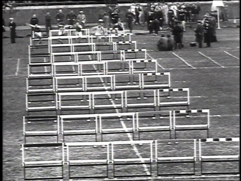 1930 WS Athletes jumping over hurdles during race / Philadelphia, Pennsylvania, USA
