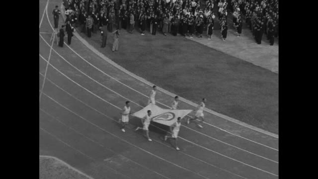 Athletes march around crowd filled National Stadium track in National Athletic Meet opening ceremony / Hirohito and wife Princess Nagako arrive /...