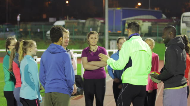 Athletes Socialising Before a Training Session