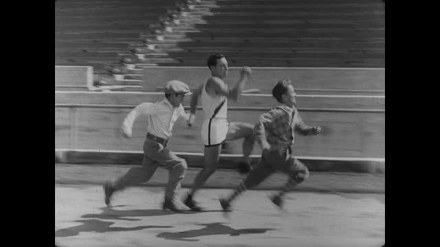 1927 athlete's (buster keaton) speed is rivaled by young boys - atletico video stock e b–roll