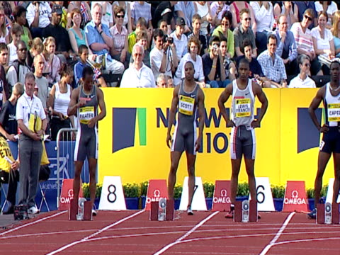 athletes wait at blocks and take marks, men's 100m heat 1, 2004 crystal palace athletics grand prix, london - track and field event stock videos & royalty-free footage