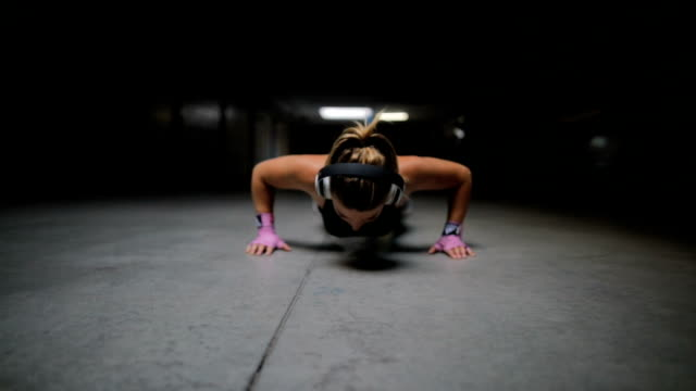 athletic beautiful woman does push-ups - headphones stock videos & royalty-free footage