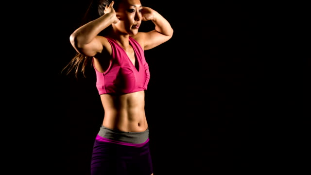 athletic female working out - flexing muscles stock videos and b-roll footage
