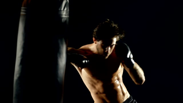 athletic male workout boxing slow-motion - fighter stock videos and b-roll footage