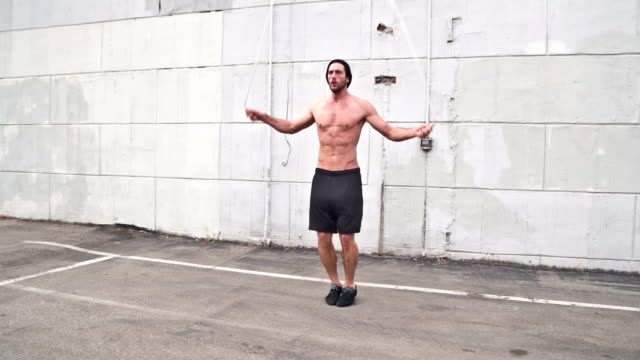 Athletic Male Workout Jumping-Rope Slow-Motion