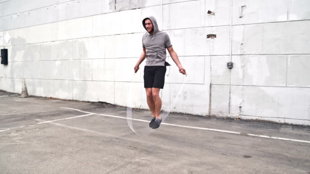 Athletic Male Workout Jumprope Slow-Motion