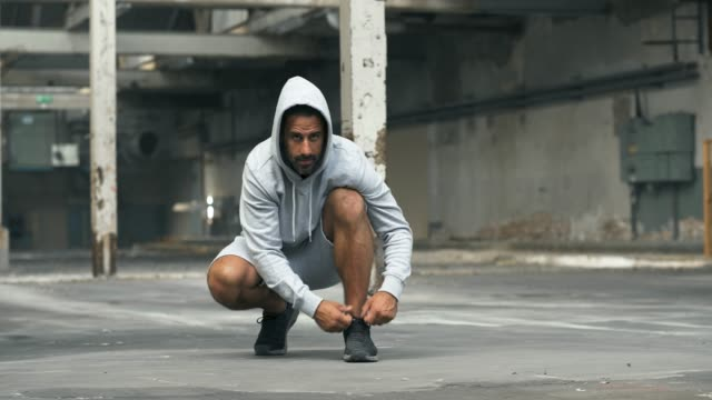 athletic man tying his shoes before a workout - anticipation stock videos & royalty-free footage