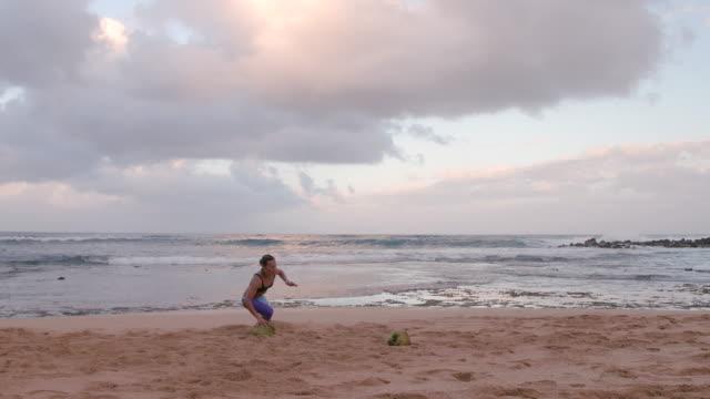 athletic pacific islander woman running up beach - pacific islander stock videos & royalty-free footage