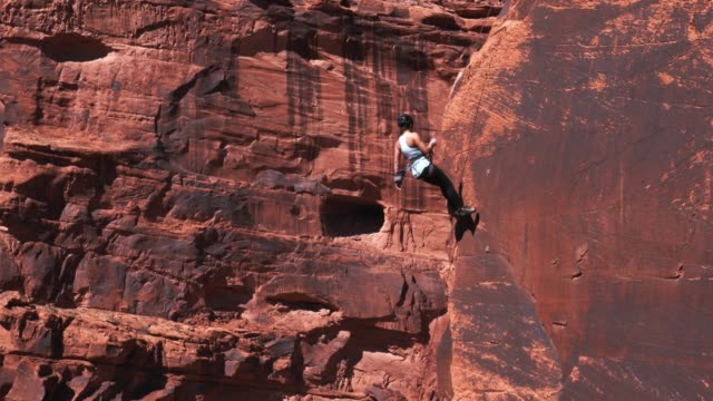 athletic rock climbing woman in moab - rock climbing stock videos and b-roll footage