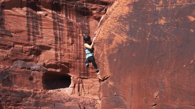 Athletic Rock Climbing Woman in Moab